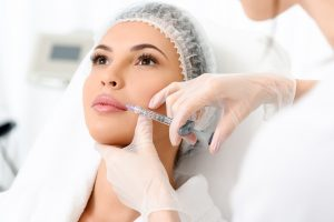 Calm young woman is getting botox treatment. Beauty therapist has recently be on a Botox training course in Cheshire
